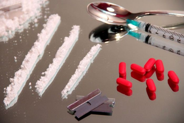 drug-paraphernalia-were-a-number-of-red-oblong-tablets-rows-or-lines-725x483